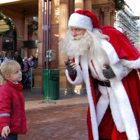 Julie, 4 years old, says hello to father Christmas at Tivoli in Copenhagen.
