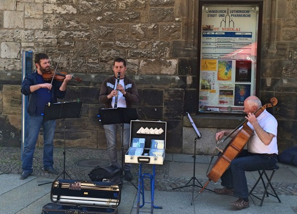 Violin, clarinet and cello, concert by great musicians outside Saint Nicholas Church in Leipzig, gave the classical place a great atmosphere    <div title=