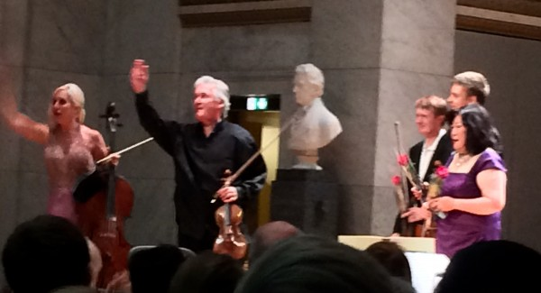All the outstanding soloists being applauded from the completely full Aula at the Old University in Oslo, surrounded by Edvard Munch paintings. Photo Henning Høholt