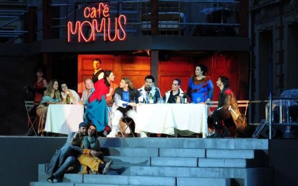 La Boheme 2.nd act at Cafe Momus, - Foto from Opera en plain Air at Facebook. Illustration photo.