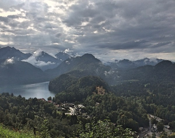 Hohenschwangau and the deep Alpsee. and the Alps. View from Neuschwangau