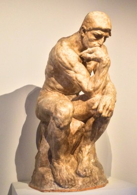 "The famouse Thinker, that can be bought in nearly all souvenirs shops in Paris, in different colors, I have it in black at my toilet. Beautiful.  but see next photo, where Georg Baselitz, German sculpturer in 2009 made his impression of it;; ""Valt ding zero)"